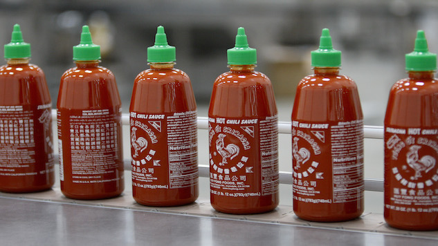 IRWINDALE, CA - MAY 14: Sriracha Hot Chili Sauce is bottled at the Huy Fong Foods plant on May 14, 2014 in Irwindale, California. Huy Fong Foods is at legals odds with the Irwindale City Council and residents of nearby houses where some have complained of ill effects caused by strong pepper odors during the fall pepper crushing season at the plant. (Photo by David McNew/Getty Images)